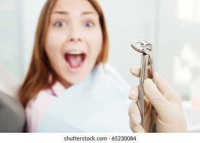 portrait of scared woman at dentist's office
