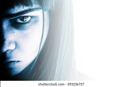 Portrait of scary girl staring at cameras,Aggressive woman with scary eyes,Horror background for halloween concept and book cover ideas
