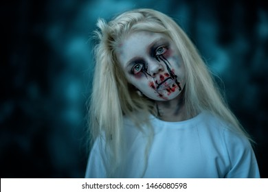 A portrait of a scary pale girl from horror film. Zombie, halloween.