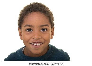 A portrait of a school aged boy isolated on white