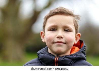 Portrait of school boy in spring park, London