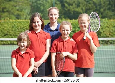 Portrait Of School Tennis Team With Teacher