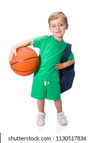 Portrait of a schoolboy with backpack holding a basketball, isolated on a white background