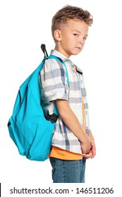 Portrait of a schoolboy with backpack, isolated on white background