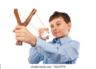 Portrait of a schoolboy sending notes or messages with slingshot and a piece of crumpled paper