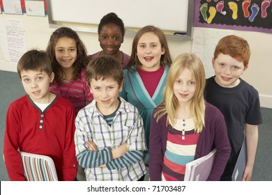 Portrait Of Schoolchildren Standing In Classroom