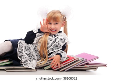 Portrait of a schoolgirl on a stack of books.
