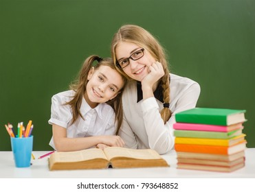 portrait of a schoolgirl and a teacher at school
