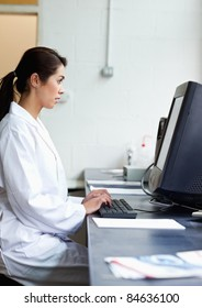 Portrait of a science student using a monitor in a laboratory