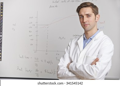 Portrait Of Science Teacher Standing In Front Of Whiteboard