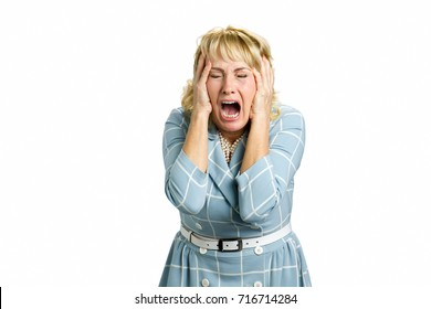 Portrait of screaming dissapointed woman. Portrait of stressed and frustrated white-skin woman screaming with desperate and horrified expression, white background.