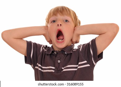 Portrait of a screaming young boy on white background
