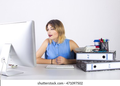 Portrait of a secretary girl on computer