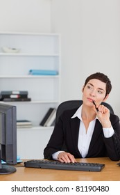 Portrait of a secretary thinking in her office