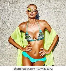 Portrait of seductive woman in bikini and sunglasses
