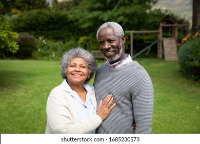 Portrait of senior African American couple in the garden, embracing and smiling. Family enjoying time at home, lifestyle concept