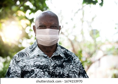 portrait of senior African man using medicine healthcare mask for health medical care, protect Covid-19 and Air pollution pm2.5