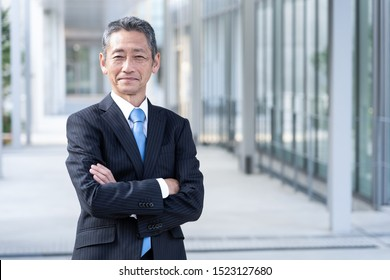 portrait of senior asian businessman standing