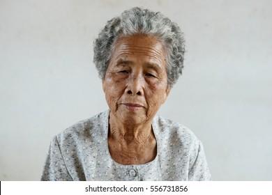 Portrait of senior asian woman on white background
