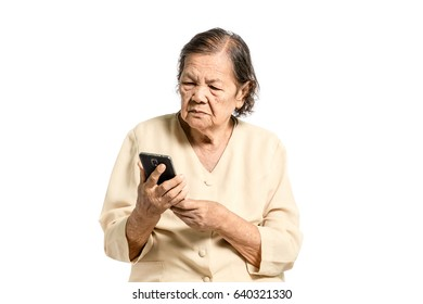 Portrait of a senior asian women looking at smartphone. Isolated on white background with clipping path