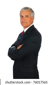 Portrait of a senior business man with his arms crossed. Vertical format isolated on white.