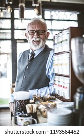 Portrait of senior businessman at coffee shop.