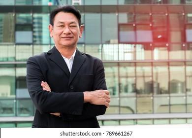 Portrait senior businessman on urban background
