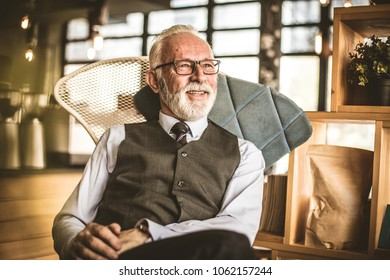 Portrait of senior businessman sitting at his office.