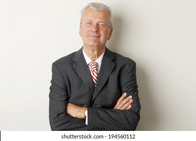 Portrait of senior businessman standing at office.