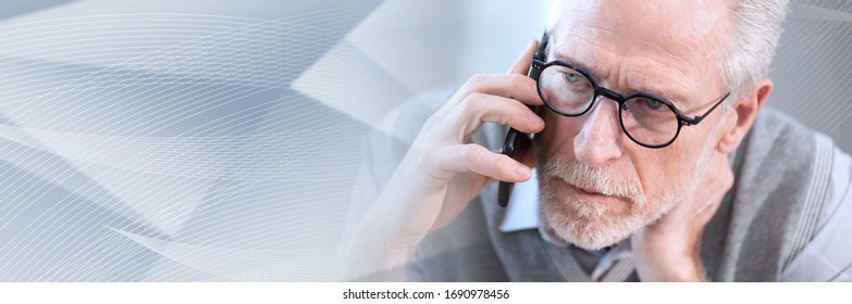 Portrait of senior businessman talking on mobile phone; panoramic banner