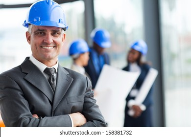 portrait of senior construction manager with arms crossed
