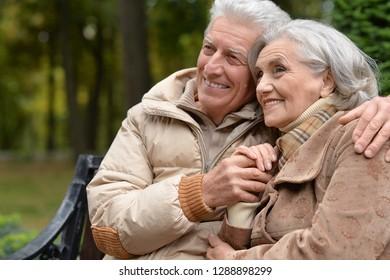 Portrait of senior couple in autumn park hugging