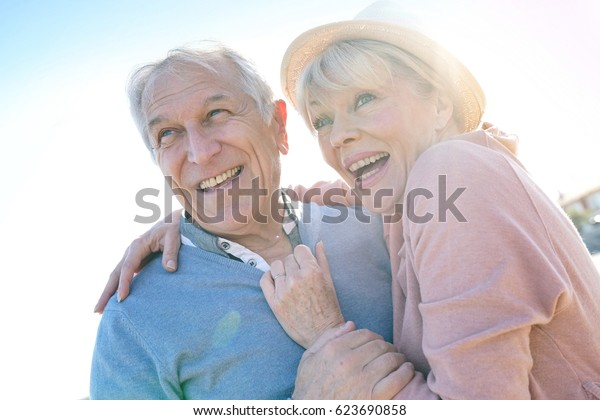 Portrait of senior couple at the beach