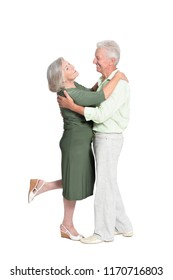 Portrait of a senior couple dancing on white background