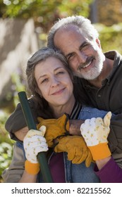 Portrait of a senior couple doing yard work