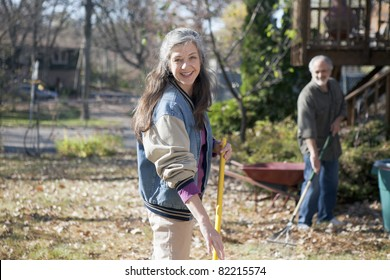 Portrait of a senior couple doing yard work