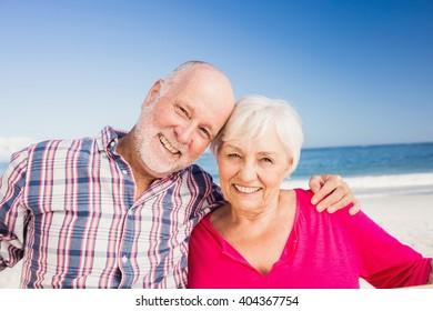 Portrait of senior couple embracing on the beach