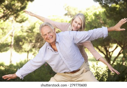 Portrait Of Senior Couple Having Fun In Countryside
