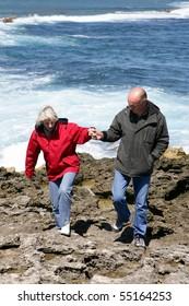 Portrait of a senior couple having a walk at seaside