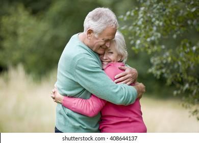 Portrait of a senior couple hugging, outdoors