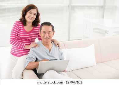 Portrait of a senior couple learning how to use a laptop