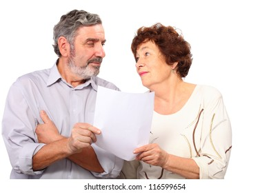 Portrait of senior couple with list of paper, isolated
