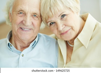 Portrait of senior couple looking at camera with smiles