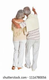 portrait of  senior couple, man showing something