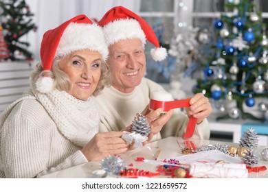 Portrait of senior couple preparing for Christmas