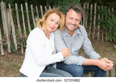Portrait of senior couple relaxing in garden