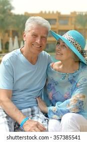 Portrait of a senior couple relaxing near  hotel resort