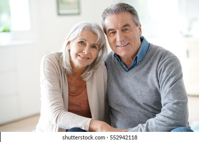 Portrait of senior couple relaxing in sofa