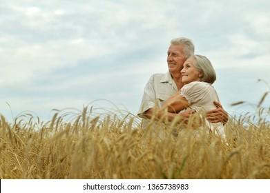 Portrait of senior couple resting at summer field