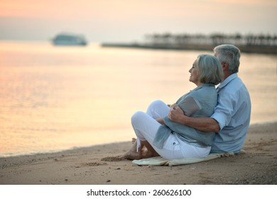 Portrait of a senior couple at sea at sunset